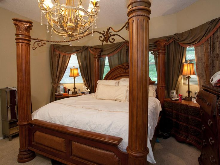 This Master Bedroom Has Over Sized Ornate Dark Wood Furniture The Chandelier Is Dripping In