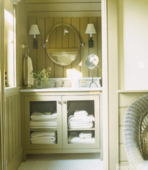 Green bathroom, chicken wire cabinets...