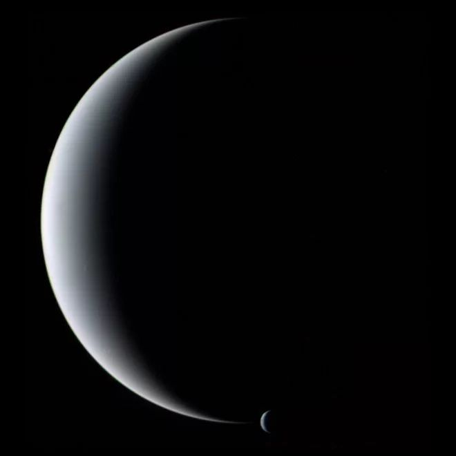 NEPTUNE & TRITON >>>>   eff Hall, director of the Lowell Observatory in Flagstaff, Ariz., chose this image of a crescent Neptune and Triton captured by the Voyager 2 spacecraft. Hall used this image in a presentation accompanied by the music of Gustav Holst's The Planets. Hall noted that when Holst wrote the music about 100 years ago, Pluto had not yet been discovered, and a scientist named Vesto M. Slipher was making measurements that laid the groundwork for the later discovery that there…