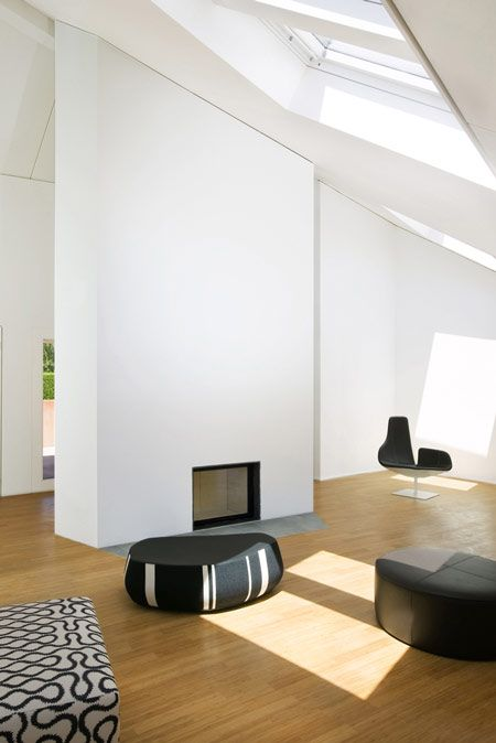 Let there be Light...and height.  I would personally add comfortable furniture, but the space is lovely.