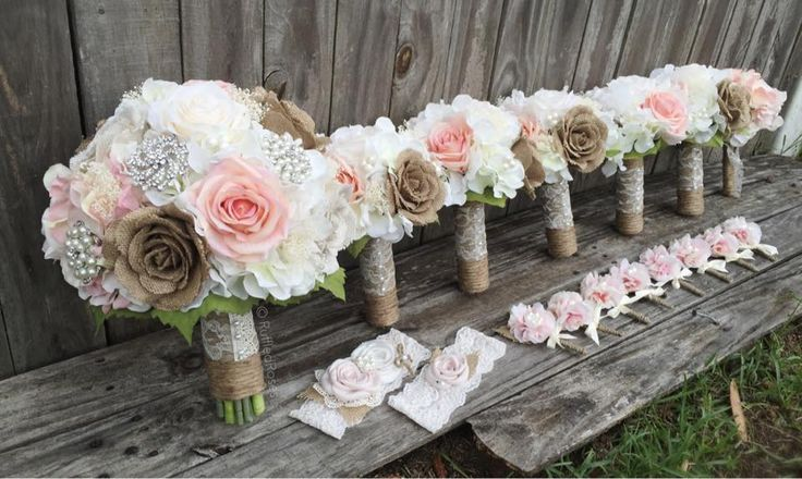 "Custom Ordered Bridal Package  This gorgeous set will be going out to a bride having an elegant, rustic country wedding with beautiful blush & ivory roses, burlap roses, and ivory hydrangeas accented with baby's breath, pearls, and lace. (1) 10"" Bridal Bouquet  (5) 6"" Bridesmaids Bouquets  (1) Toss Bouquet  (8) Bridal party boutonnières  (1) Garter Set  Cake cluster flowers"