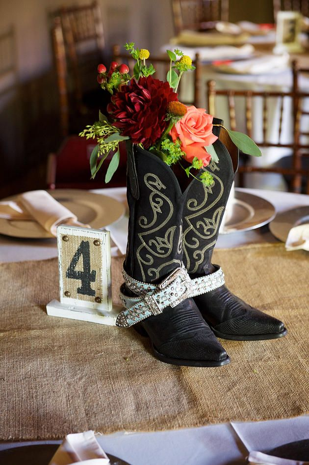 Please do put your feet on the table! Elegant cowboy boots with bling belts and pretty blooms made for a fashionable – and surprising – centerpiece at this barn wedding! Fun and creative idea by wedding planner and designer, Georgia Barron. Floral design by Visual Impact Design in Sacramento, CA. Sharpe Wedding Photography. Venue: Newcastle Wedding Gardens.