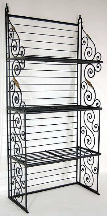Attractive charm and sensible functionality are married in this artfully hand forged French antique Baker's Rack. Three deep shelves provide ample room for all of your accessories and culinary accoutrements, while whimsical scrollwork along the sides articulates the artistry of the metalworker. This antique Baker's Rack held many offerings of the talented French baker over a century ego.