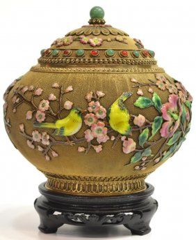 """Very fine Chinese silver-gilt filigree and enameled covered jar w/ a jade bead on the domed top, alternating aventurine quartz and carnelian cabochons, enameled songbirds on enameled flowering branches, gilded woven mesh ground and applied beadwork and banding on foot and rim. Marked silver underfoot. Jar approx: 6.5""""h, 3.5lbs. Austin Auction Gallery."""