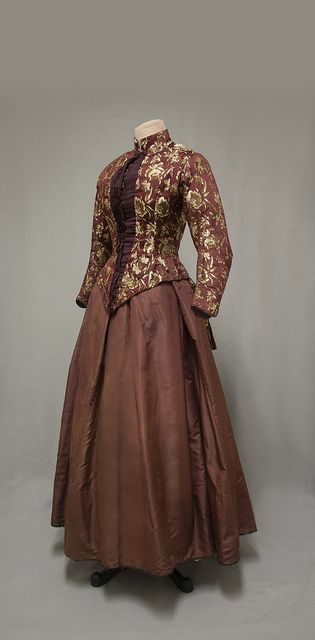 1850–1900. Cranberry brocade bodice and maroon silk taffeta skirt, 1880. 1974 gift from Mrs. Fitch Cheney to the University of Connecticut Historical Clothing and Textile Collection. (William Benton Museum of Art - Press Images)
