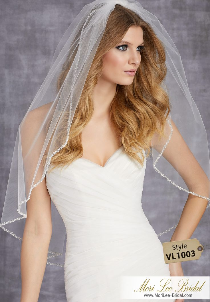 Style VL1003Veil Edged with Pearls and BeadsAvailable in Fingertip Length (VL1003F) Shown, or Cathedral Length (VL1003C). Colors: Options: White, Ivory, Gold.