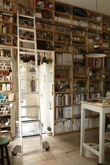 Studio - look at all those shelves!  And, with a rolling ladder to boot! Essential storage when you're so short on space