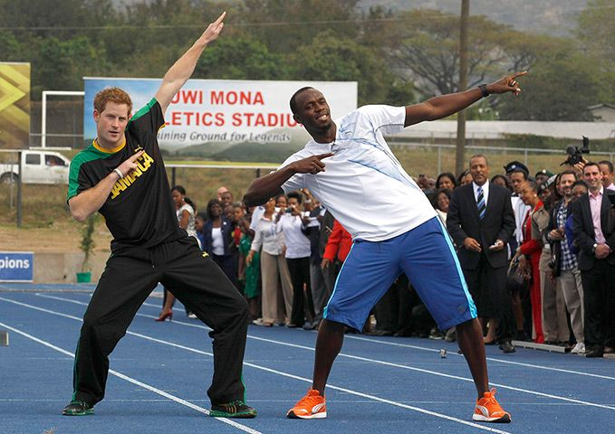 The prince and the sprinter strike Bolt's signature pose on the Usain Bolt track at the University of the West Indies in Kingston, Jamaica