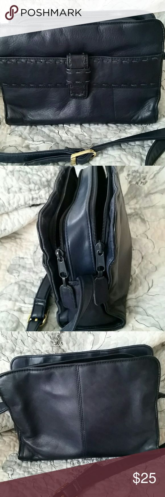 Leather crossbody or shoulder navy Hunt Club purse Navy leather crossbody or shoulder bag purse, soft leather with navy stiching accent, 10 inches wide, 6 inches tall and 3 inches in depth. Long adjusting strap with gold buckle. Small to medium size. Hunt Club Bags Crossbody Bags