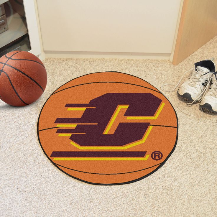 """Central Michigan University Basketball Mat 27 diameter - For all those hoops fans out there: basketball-shaped area rugs by FANMATS. Made in U.S.A. 100% nylon carpet and non-skid recycled vinyl backing. Machine washable. Officially licensed. Chromojet printed in true team colors.FANMATS Series: BASKETBTeam Series: Central Michigan UniversityProduct Dimensions: 27"""" diameterShipping Dimensions: 27""""x14""""x0.5"""". Gifts > Licensed Gifts > Ncaa > All Colleges > Central Michigan University. Weight…"""