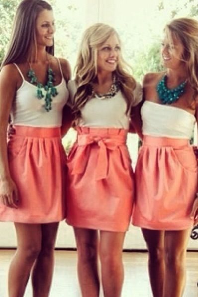 Instead of having bridesmaid dresses, have the bridesmaids wear a coral skirt and chose their own white blouse. Accessorize with teal jewelry and not only will you have a cute bridesmaids outfit, but also an outfit your bridesmaids can wear again!