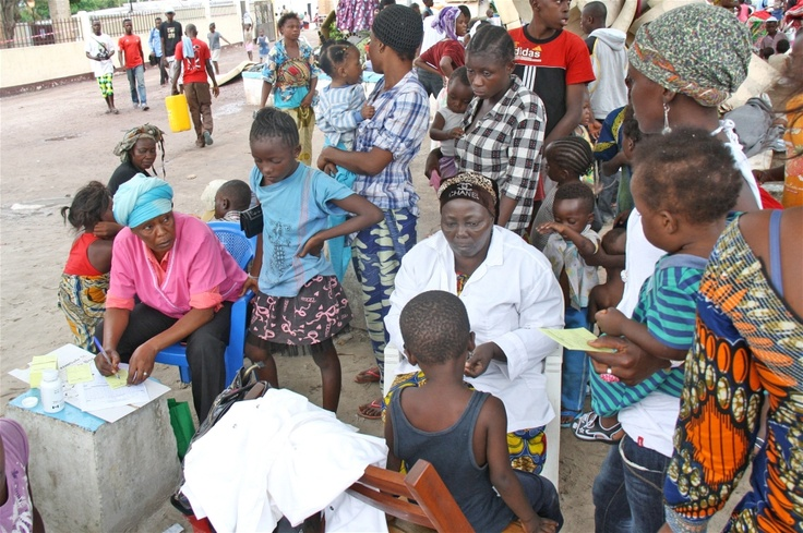 Children displaced when munitions in an army depot in Brazzaville blew up on 4 March 2012 are vaccinated against measles