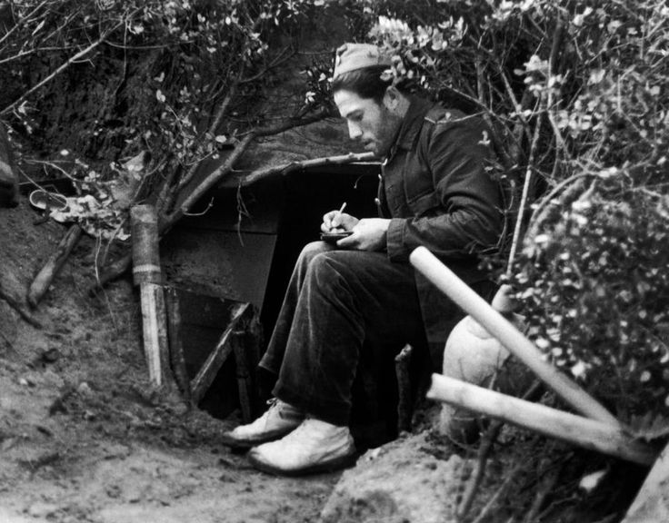 Madrid, Spain. Republican Soldier writing a letter. By Robert Capa, (November-December 1936)