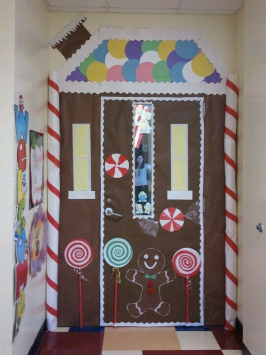 Gingerbread door decoration @Ashley Towne @Caitlyn Anderson  Can we please do this to our door for Christmas!!!