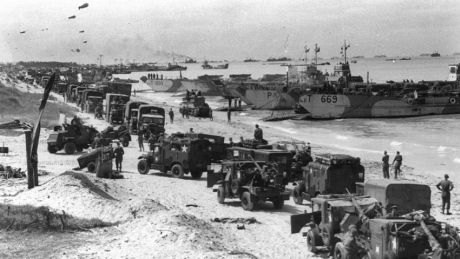 Troops and landing craft occupy a Normandy beach shortly after the D-Day landing