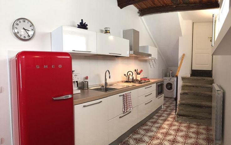 Kitchen with red SMEG fridge and mediterranean Vietri tiles, Studio Bellavista, Pizzo Calabro