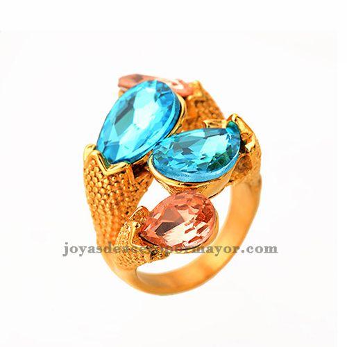 Anillo dorado lujoso con piedras azules y rosadas para damas