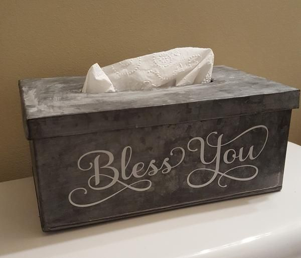 The perfect size for a standard box of tissues. Metal base and removable lid. Bless You is applied with durable outdoor vinyl adhesive. The listing shows the lettering in light gray. If you'd like another color, please message me at checkout. **Please message me in the Seller Note section at checkout with any questions or special requests. Colors on your computer may vary from the actual colors in our color chart depending on your screen resolution and picture quality. Plush strives t...
