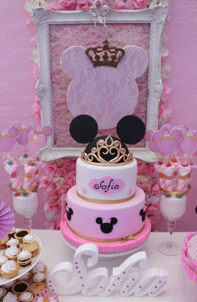 Gorgeous cake at a pink and gold Minnie Mouse baptism party! See more party planning ideas at CatchMyParty.com!