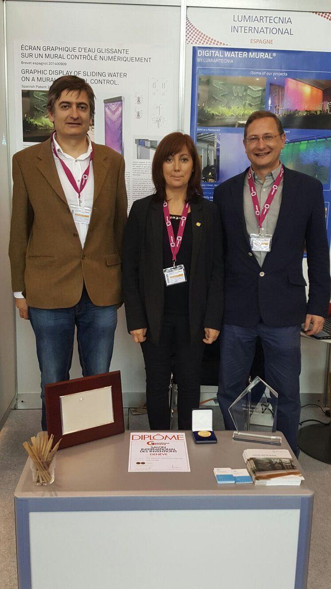 "We have been awarded the best Spanish invention in Geneva and gold medal with a special mention of the jury in the 45th International Exhibition of Inventions of Geneva for our patented invention ""Digital Water Mural"".  In the center of the photo, president of the Spanish Patent and Trademark office."