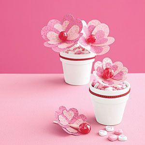 Lollipop Flowers - using heart shaped paper (or tissue paper), glue, tape, lollipop, flower pot and ribbon