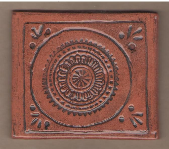 Stamped and carved terracotta tile by Bella Odendaal