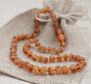 Amber Teething Necklace - cool invention that babies can suck on, can't break and looks beautiful! $17.95 for this one (raw amber necklace for teething - honey sunshine beads) www.amberartisans...