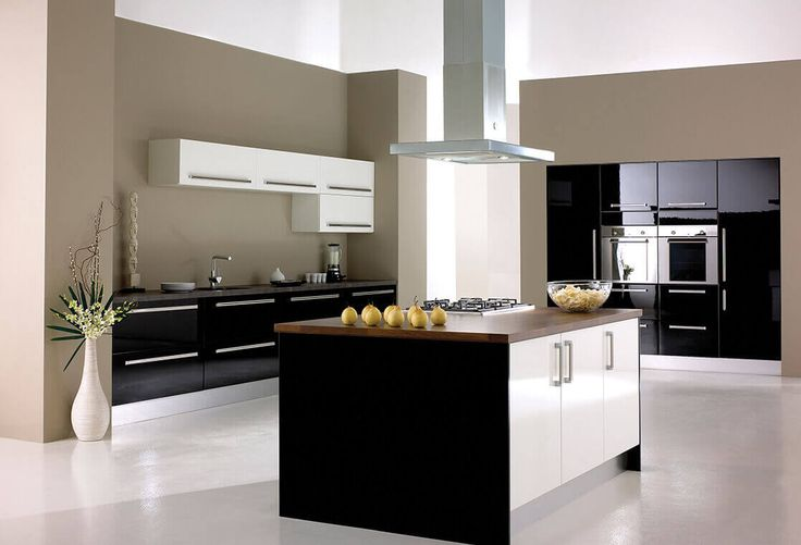 Machair Collection Add a touch of drama to your home with this high-gloss black and white fitted kitchen with dark oak wood kitchen worktops