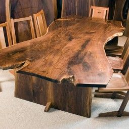 Dumonds Custom Wood Furniture - Dumonds offers custom wood furniture including corporate office tables, chairs, benches, dining room sets and bedroom items.