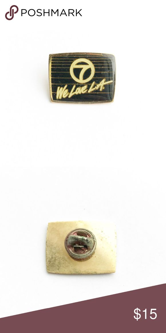 """Vintage 'We Love LA' Enamel Pin Vintage We Love LA Enamel Pin  • true vintage • 1"""" x 7/8"""" • color: black, gold, white • tags: L.A., Los Angeles, California, home town, San Diego, Hollywood, Malibu, Long Beach, Santa Barbara, Santa Monica, Santa Cruz, Huntington, Newport, Beverly Hills, channel 7 tv show • all of the pins I sell are vintage & may contain minor nicks, imperfections, or oxidation Vintage Accessories"""