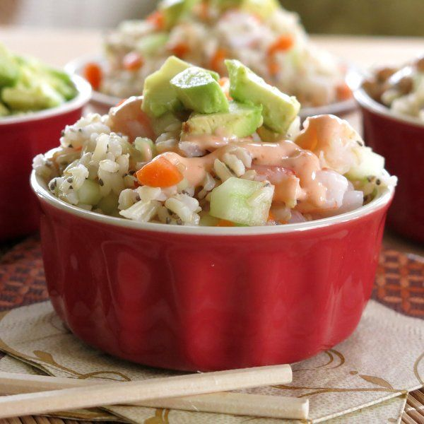 Shrimp Sushi Roll Salad with Spicy Dressing Recipe Salads with cooked brown rice, seasoned rice wine vinegar, chia seeds, cooked shrimp, carrots, cucumber, avocado, mayonnaise, Sriracha, honey, seasoned rice wine vinegar