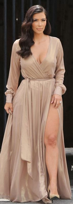Kim Kardashian wearing Michael Costello gold long sleeve wrap gown and Saint Laurent tan suede pumps