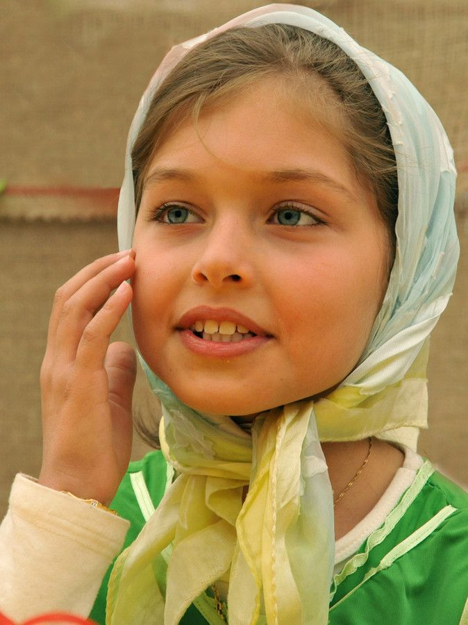 She was originally labelled as a Persian (aka Iranian) but I think she is actually from the Kalash or the Nuristani Peoples.
