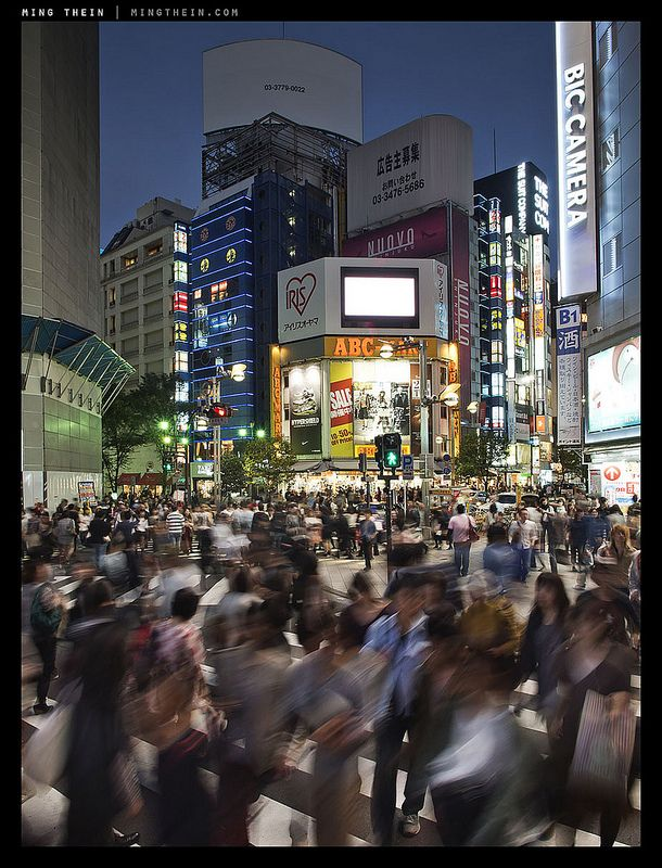 From Shinjuku nights. Handheld whilst clinging to the side of a lamp post for elevated perspective; very long shutter and no possibility to use a tripod. IBIS on the E-M5 to the rescue for the shutter speed, a smaller sensor for greater DOF.  Image by Ming Thein.