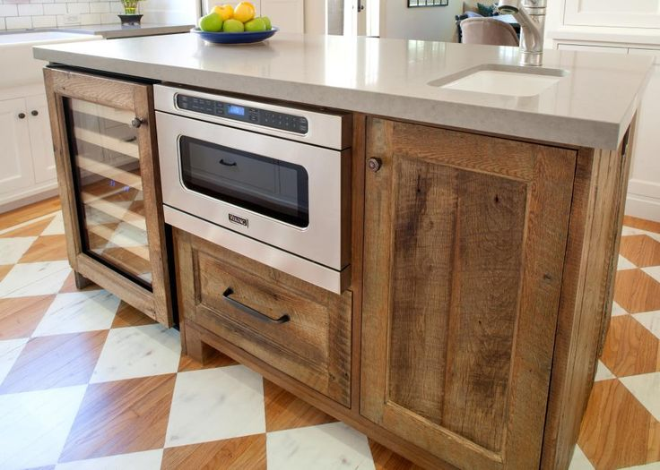This Rustic Kitchen Island Features Natural Wood Cabinetry With A Built In  Wine Cooler And