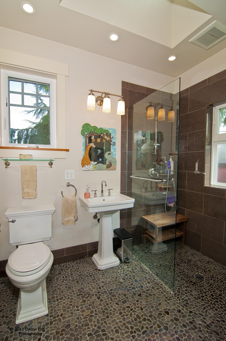 New Upper Bath features tile floor and shower surround, 'zero' edge roll-in shower pan, blocked wall for future grab bars at w.c., recessed lighting and 2' x 2' skylight with flared opening. Darryl Eng Photo 2011