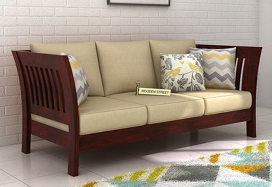 Get Raiden 3 Seater Wooden Sofa Online in Mahogany Finish. The simple three seater wooden sofa with beautiful finish gives nice look. The 3 seater sofa online range is amazing to make the best choice. Buy 3 seater sofa online at affordable price in #Ahmedabad #Jaipur #Noida #Bhopal