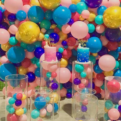 Fun colourful with metallic gold orbz balloon wall