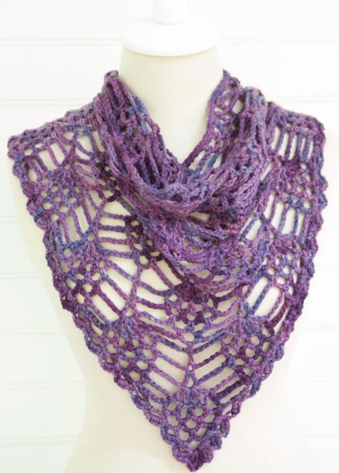 The Berry Harvest Crochet Cowl is a stunning, intricate piece with fun style variations. Whether you wear it like a shawl, pin it with a button to make a bandana cowl, or shrink it to make a hair bandana, this free crochet cowl pattern doesn't need any other accessories to stand out. Wearable crochet makes it possible to achieve a visually dynamic draped effect without weighing your neck down with heavy chain accessories. The variegated yarn looks stunning in these shades of purpl...