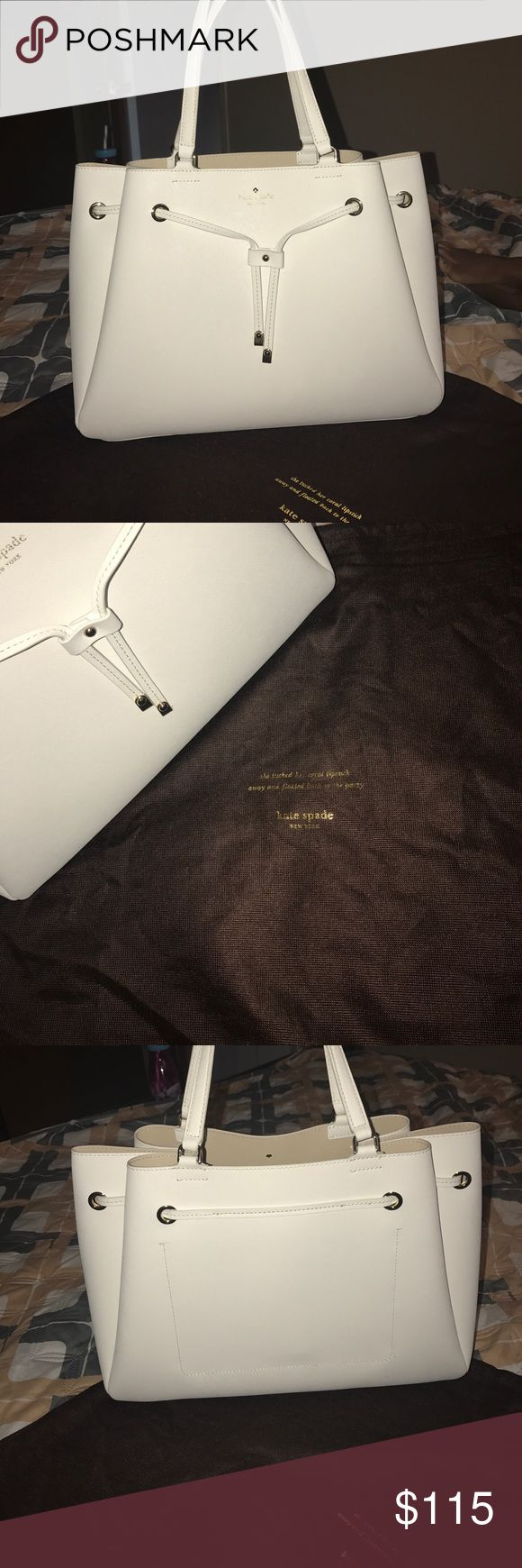 Cream Kate Spade Bag 💼 Beautiful Cream Kate Spade Bag like new only worn once no stains no marks it's medium/large comes with dust bag purchased from Nordstrom Rack still have tags kate spade Bags Totes