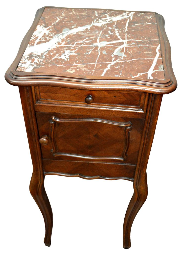 French nightstand made from patinated wood consisting of a serpentine-shaped top inset with Rouge Royal marble, circa 1870. Lovely embellished façade features a single drawer above a single door...