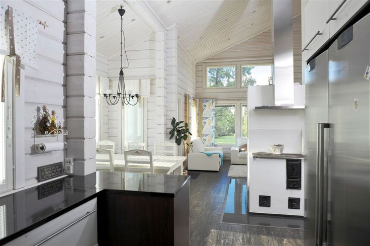 Light walls + white kitchen cabinets + black counter tops