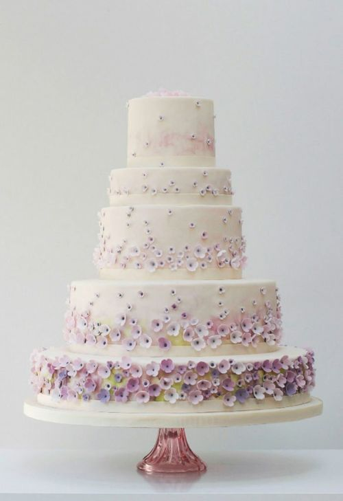 Lovely Wedding Cake with hand crafted flowers and watercolour detail.  Lovely cake!