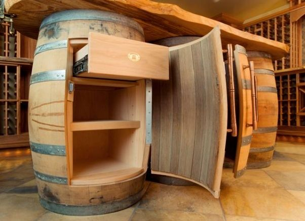 Inspiration for Wine barrel cabinets. We sell used whiskey barrels with much more patina that would look great!
