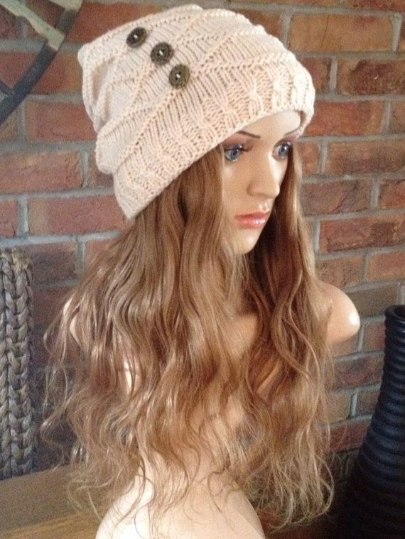 Stylish button detail Beanie hat and cap liner with 100% human wavy hair attatched for cancer patients and alopecia sufferers. Available in sizes: