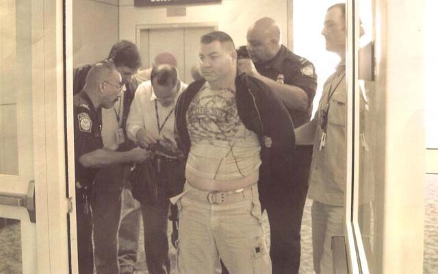 United Nations gang leader Clay Roueche being taken into custody in Texas on May 17, 2008. Roueche was turned away from Mexico and forced to land in the United States where he was arrested on drug charges.