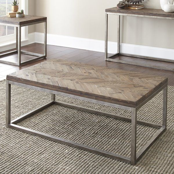 Whether you love curling up on the couch with a glass of wine to unwind from a long day or you were born to host casual cocktail nights, this charming coffee table is a timeless addition to any abode. Its distressed acacia top features a handsome herringbone pattern that adds classic appeal to your space, a stylish stage for a bouquet of flowers from your garden, and a stack of your favorite magazines. Enhance its farmhouse flair by arranging a well-worn leather sofa and linen armchair…
