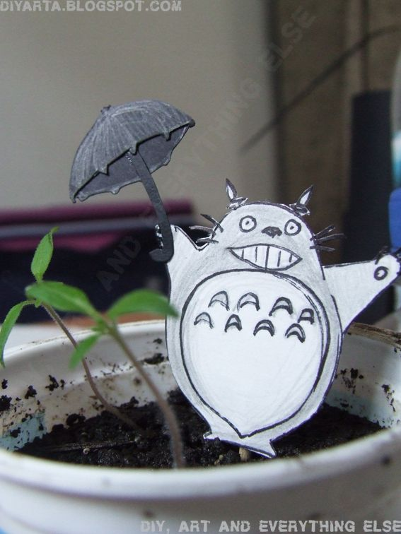 My Totoro :) It is a little paper form in a toothpick, live with my flowers.