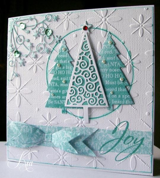 I started this card thinking about a different design, changed my mind after I already cut the hole! The embossing folder is Sizzix Winter Set #2. The trees are on pop dots and the sentiment is computer generated. I did not make it for the challenge, but noticed after I made it, that it kind of works - that tiny rhinestone on the tree top!!