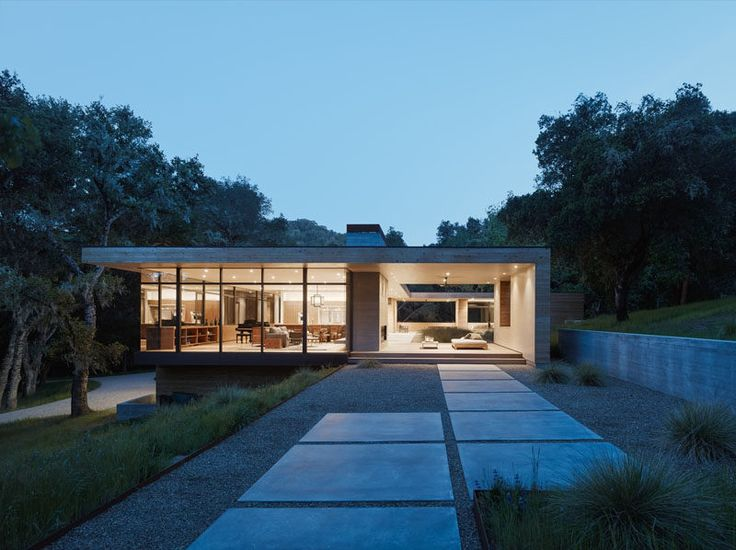 This home has been designed to have the indoor living areas on one side, and outdoor living areas on the other.